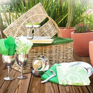 Hand woven straw picnic basket with green material