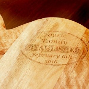 Personalised Kiaat wood heart shaped chopping board
