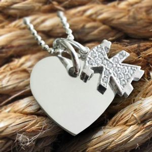 Sterling silver heart and sparkly kid charm